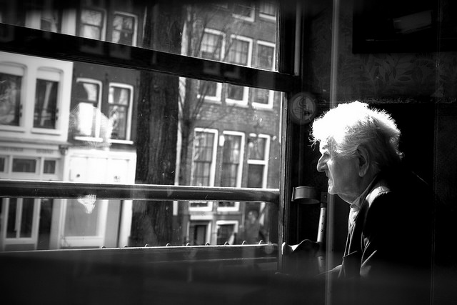 Old-man-staring-out-window-14171645229_b291647d44_z