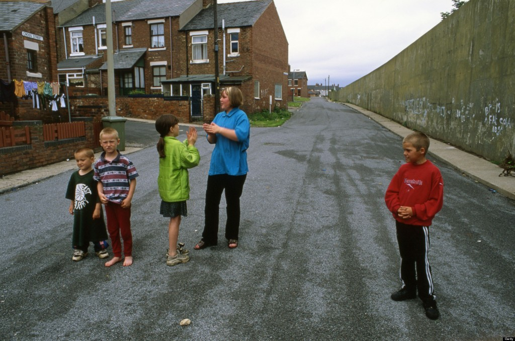 Children playing in street of the former mining town of Easington Co Durham UK