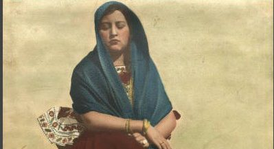 """Photograph of  """"Woman on Street – Blue Scarf, Red Dress"""""""